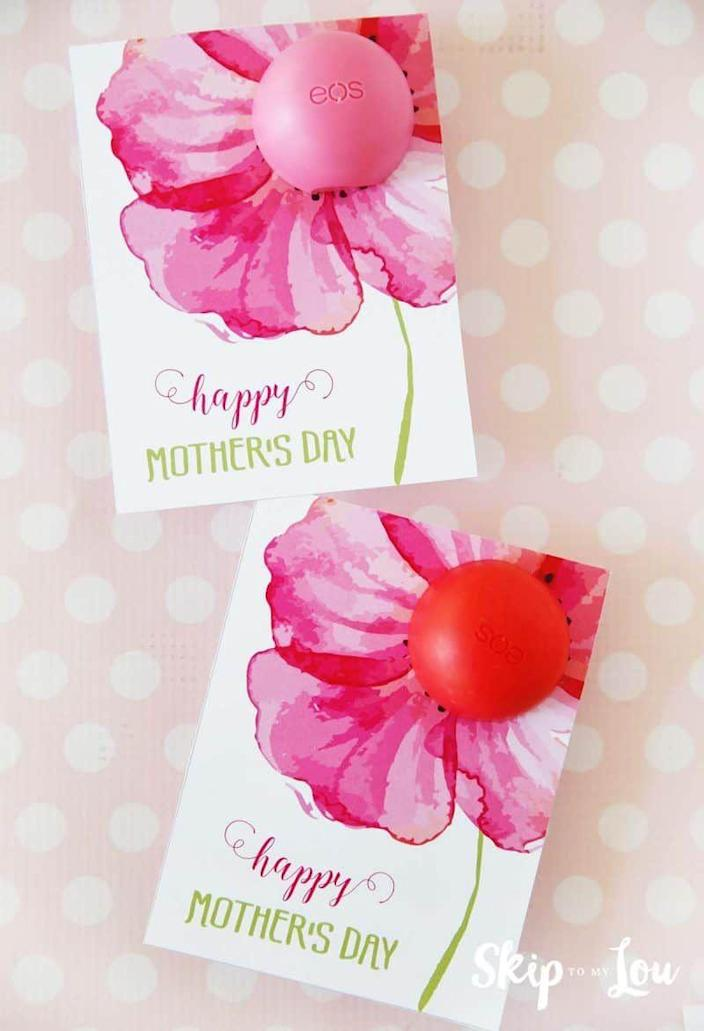 """<p>This gorgeous card comes with a spot to punch a hole that an EOS lip balm fits into perfectly.</p><p><strong>Get the printable at <a href=""""https://www.skiptomylou.org/eos-lip-balm-printable-mothers-day-cards/"""" rel=""""nofollow noopener"""" target=""""_blank"""" data-ylk=""""slk:Skip to My Lou"""" class=""""link rapid-noclick-resp"""">Skip to My Lou</a>.</strong></p><p><strong><a class=""""link rapid-noclick-resp"""" href=""""https://www.amazon.com/Evolution-Hydration-Collection-Hibiscus-Wildberry/dp/B07KF31TJC/?tag=syn-yahoo-20&ascsubtag=%5Bartid%7C10050.g.3195%5Bsrc%7Cyahoo-us"""" rel=""""nofollow noopener"""" target=""""_blank"""" data-ylk=""""slk:SHOP EOS LIP BALM"""">SHOP EOS LIP BALM</a><br></strong></p>"""