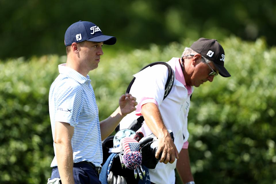 DUBLIN, OHIO - JULY 18: Justin Thomas of the United States and his father and caddie Mike Thomas walk on the 18th hole during the third round of The Memorial Tournament on July 18, 2020 at Muirfield Village Golf Club in Dublin, Ohio. (Photo by Jamie Squire/Getty Images)