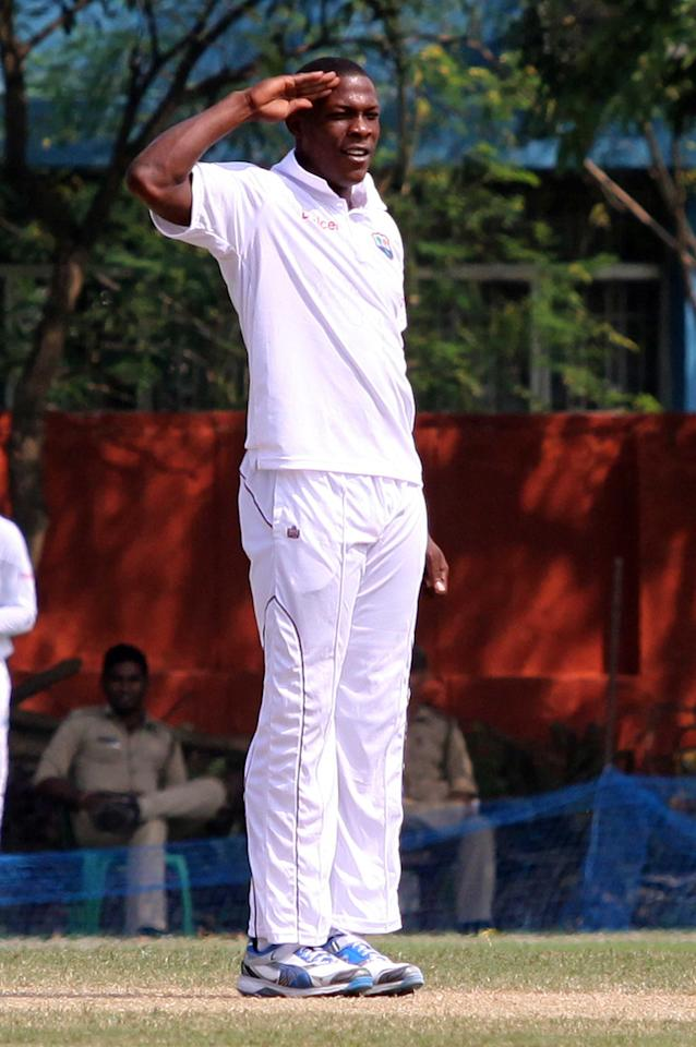 West Indies player S Cottrel celebrates a wicket during day three of practice match between West Indies and Uttar Pradesh Cricket Association XI at the Jadavpur University Ground in Kolkata on Nov. 2, 2013. (Photo: IANS)