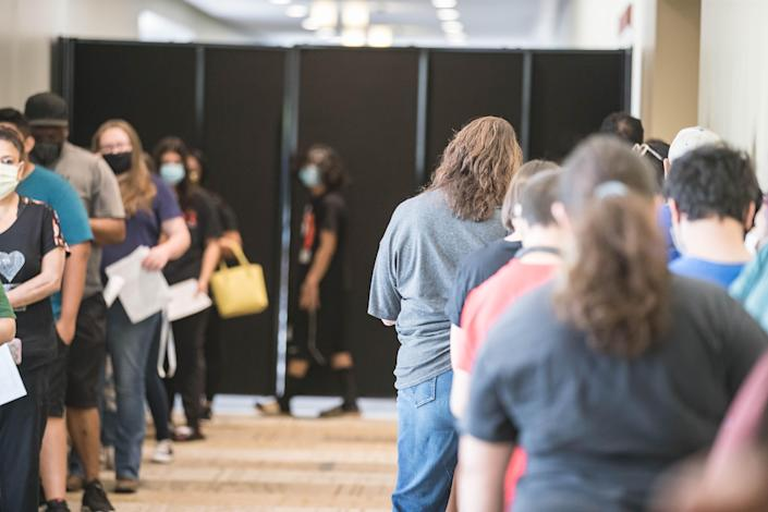 People wait in line for a $100 incentive the New Mexico Department of Health offers for getting a vaccine shot at a vaccination event at the Las Cruces Convention Center in Las Cruces on Wednesday, June 16, 2021