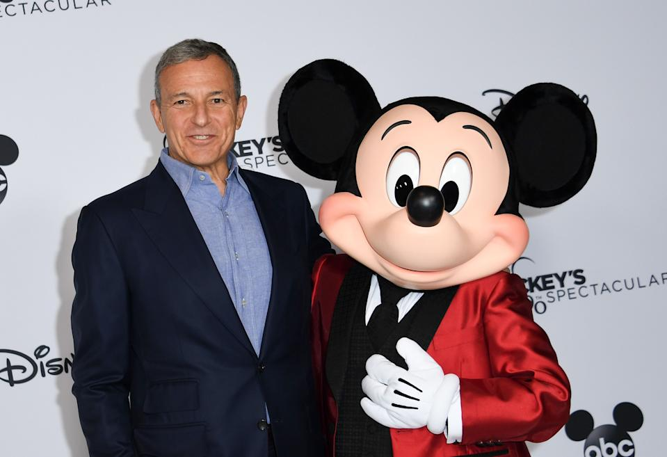 Walt Disney Company Chairman and CEO Robert A Iger poses with Mickey Mouse attends Mickey's 90th Spectacular at The Shrine Auditorium on October 6, 2018 in Los Angeles. (Photo by VALERIE MACON / AFP)        (Photo credit should read VALERIE MACON/AFP via Getty Images)