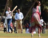 William and Kate go head to head in a cricket match during their royal tour of India and Bhutan in April 2016.<em> [Photo: PA]</em>