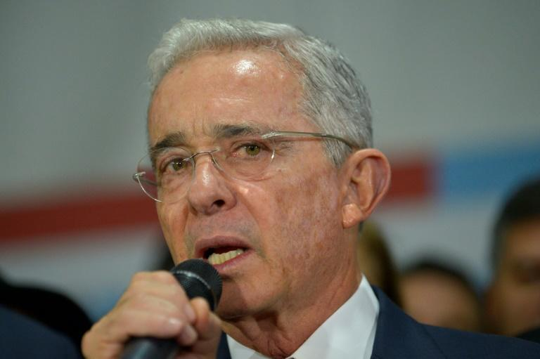 Former Colombian president Alvaro Uribe speaks to supporters in October 2019 at the headquarters of the Democratic Center political party in Bogota, after his hearing at the Supreme Court over witness tampering (AFP Photo/Raul ARBOLEDA)