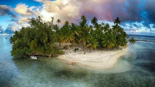 "<p>Drinks, water, sun, and rainbows — this is Tahiti. <i>(Photo: <a href=""http://www.dronestagr.am/author/mpv/"" title=""Posts by Marama Photo Video"">Marama Photo Video</a>)</i></p>"