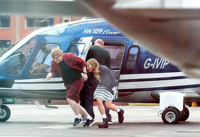 <p>The singer and his girlfriend, Cherry Seaborn, had a laugh as they caught a helicopter in London. Ah, the celeb life! (Photo: BACKGRID) </p>