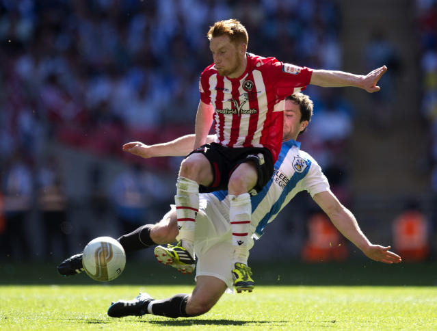 Huddersfield Town's Damien Johnson (back) comes in to challenge Sheffield United's Stephen Quinn (C) during the League 1 Play-Off Final football match at Wembley Stadium in London on May 26, 2012. Huddersfield won the game 8-7 on penalties to win promotion to the Championship next season. AFP PHOTO / ADRIAN DENNISADRIAN DENNIS/AFP/GettyImages