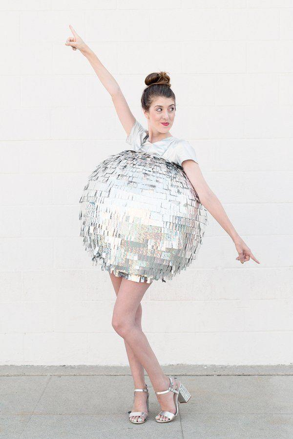 """<p>Just like a disco ball, you'll be the center of attention at your Halloween party in this shiny get-up. </p><p><strong>Get the tutorial at <a href=""""https://studiodiy.com/2015/09/30/diy-disco-ball-costume/"""" rel=""""nofollow noopener"""" target=""""_blank"""" data-ylk=""""slk:Studio DIY"""" class=""""link rapid-noclick-resp"""">Studio DIY</a>.</strong></p><p><strong><a class=""""link rapid-noclick-resp"""" href=""""https://www.amazon.com/TECKWRAP-Chrome-Holographic-Precut-Mermaid/dp/B07CPT1L8Y/?tag=syn-yahoo-20&ascsubtag=%5Bartid%7C10050.g.22500148%5Bsrc%7Cyahoo-us"""" rel=""""nofollow noopener"""" target=""""_blank"""" data-ylk=""""slk:SHOP HOLOGRAPHIC RIBBON"""">SHOP HOLOGRAPHIC RIBBON</a><br></strong></p>"""