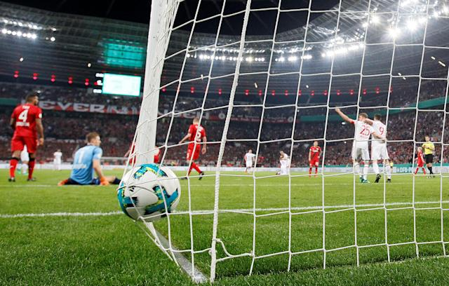 Soccer Football - DFB Cup - Bayer Leverkusen vs Bayern Munich - BayArena, Leverkusen, Germany - April 17, 2018 Bayern Munich's Thomas Mueller celebrates scoring their third goal with Robert Lewandowski REUTERS/Wolfgang Rattay DFB RULES PROHIBIT USE IN MMS SERVICES VIA HANDHELD DEVICES UNTIL TWO HOURS AFTER A MATCH AND ANY USAGE ON INTERNET OR ONLINE MEDIA SIMULATING VIDEO FOOTAGE DURING THE MATCH.