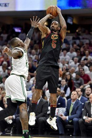 May 25, 2018; Cleveland, OH, USA; Cleveland Cavaliers guard JR Smith (5) shoots the ball against Boston Celtics guard Terry Rozier (12) during the first quarter in game six of the Eastern conference finals of the 2018 NBA Playoffs at Quicken Loans Arena. Mandatory Credit: David Richard-USA TODAY Sports