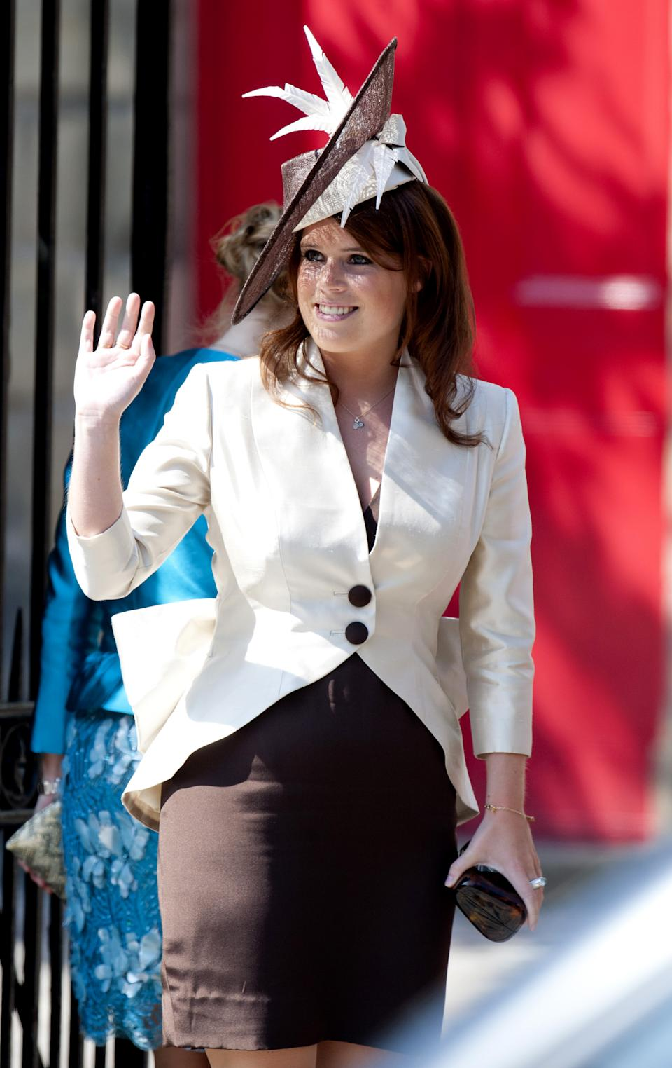 <p>Princess Eugenie chose a subdued outfit and hat at her cousin's wedding. (Mark Cuthbert/UK Press via Getty Images)</p>