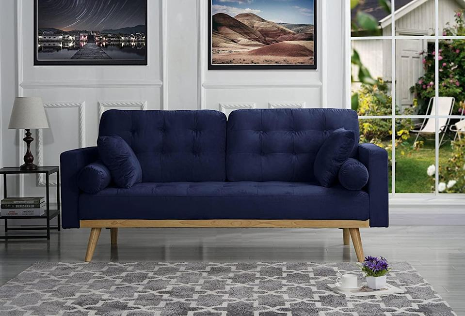 <p>The vintage style of this <span>Sofamania Mid-Century Tufted Velvet Sofa</span> ($350) makes it look so luxe and expensive. It also comes in gray, teal and purple. </p>