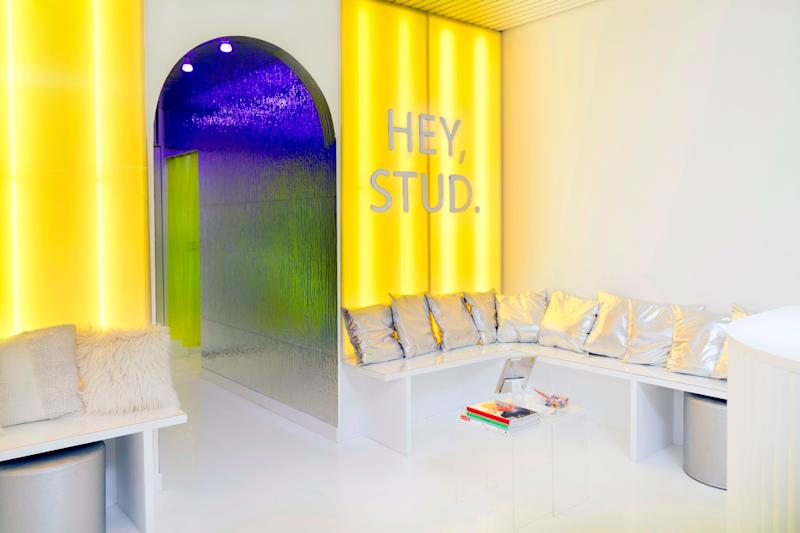 The fuzzy pillows and metallic stools are just some of the many dynamic elements inside Studs.