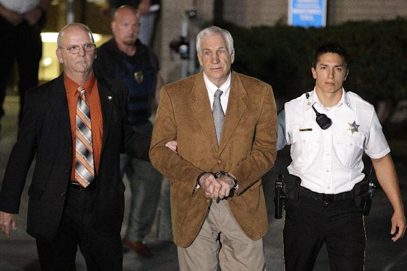 FILE - In this Friday, June 22, 2012 file photo, former Penn State University assistant football coach Jerry Sandusky, center, leaves the Centre County Courthouse in custody after being found guilty of multiple charges of child sexual abuse in Bellefonte, Pa. Sandusky, 68, will be sentenced Tuesday, Oct. 9, 2012 for sexually abusing 10 boys in a scandal that rocked the university and brought down coach Joe Paterno. Because of who he is and what he's done, Sandusky could be in particular danger of sexual assault when he is sent off to prison this week. (AP Photo/Gene J. Puskar, File)