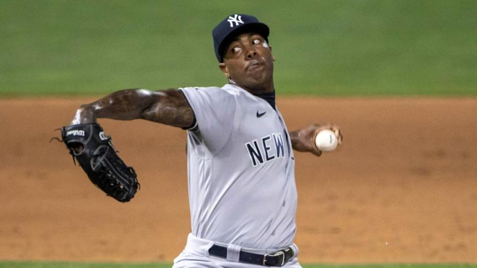 Jun 10, 2021; Minneapolis, Minnesota, USA; New York Yankees relief pitcher Aroldis Chapman (54) delivers a pitch in the ninth inning against the Minnesota Twins at Target Field.