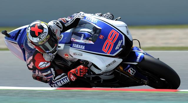 Yamaha Factory Racing's Spanish Jorge Lorenzo takes a curve at the Catalunya racetrack in Montmelo, near Barcelona, on June 1, 2012, during the MotoGP second training session of the Catalunya Moto GP Grand Prix. AFP PHOTO/LLUIS GENELLUIS GENE/AFP/GettyImages