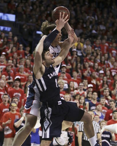 San Diego's Keith Stackhouse, front, and Gonzaga's Kelly Olynyk fight for a pass during the first half of an NCAA basketball game in Spokane, Wash., on Saturday, Feb. 23, 2013. (AP Photo/Young Kwak)