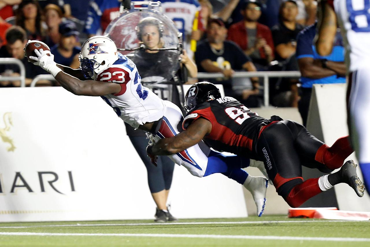 CFL Football - Montreal Alouettes v Ottawa Redblacks - Ottawa, Ontario, Canada - 19/08/2016. Montreal Alouettes Brandon Rutley scores a touchdown. REUTERS/Chris Wattie