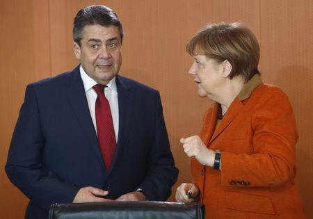 German Chancellor Merkel and Foreign Minister Gabriel before cabinet meeting at the chancellery in Berlin