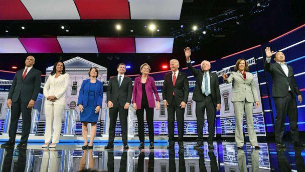 PHOTO: Democratic presidential hopefuls arrive onstage for the fifth Democratic primary debate of the 2020 presidential campaign season in Atlanta, Nov. 20, 2019. (Nicholas Kamm/AFP/Getty Images)