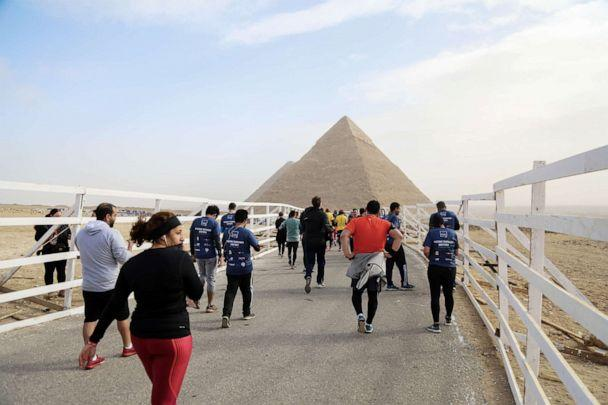 PHOTO: People gather around the Great Pyramid of Giza, which is located in the western part of capital city Cairo, in Egypt, Feb. 15, 2019. (Ahmed Al Sayed/Anadolu Agency/Getty Images, FILE)