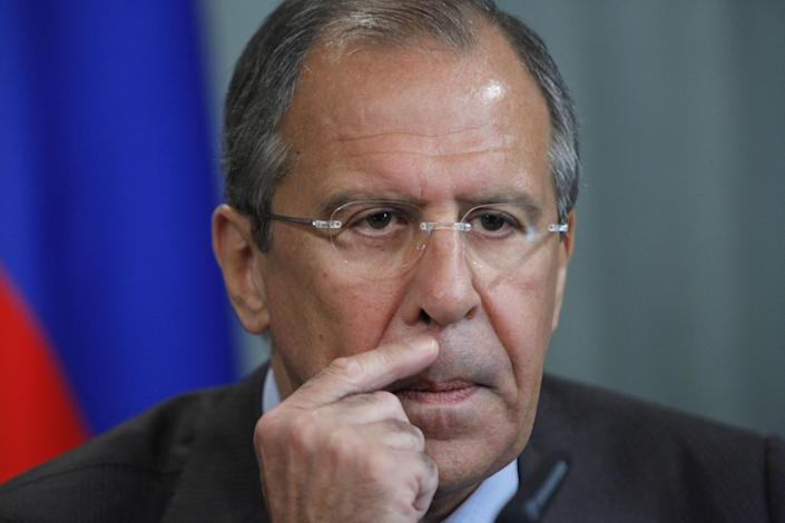 """Russian Foreign Minister Sergey Lavrov, listens to question during his and Tunisian Foreign Minister Rafik Abdessalam, unseen, news conference in Moscow, Russia, Thursday, June 28, 2012. Russia is denying comments by a U.S. official that it has endorsed a Syrian transition plan that includes a call for President Bashar Assad to give up power in favor of a national unity government saying that outside forces must concentrate on convincing opposition groups to soften their demands. But, Russian Foreign Minister Sergey Lavrov denied that Thursday. """"We are not supporting and will not support any external meddling,"""" he said. (AP Photo/Alexander Zemlianichenko)"""