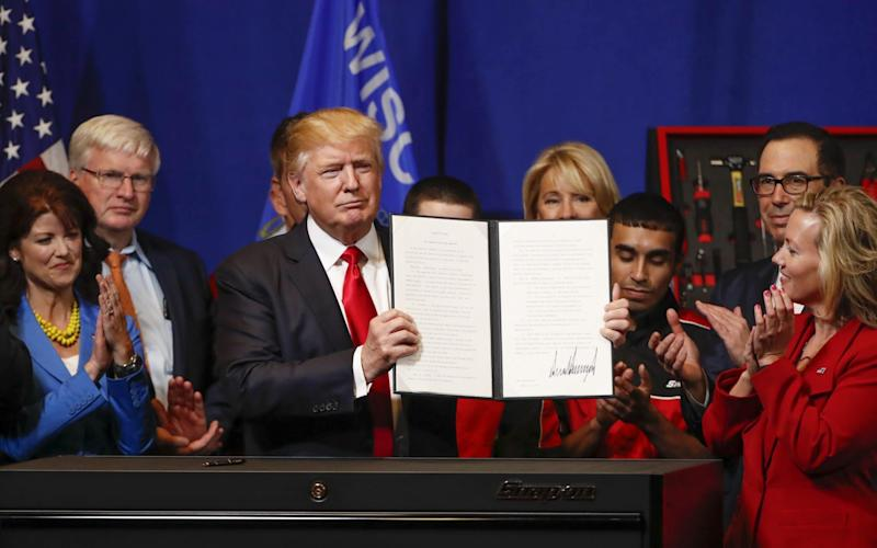 Donald Trump signs the