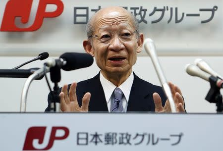 Taizo Nishimuro, president of Japan Post Holdings Co., speaks during a news conference at its headquarters in Tokyo February 18, 2015. REUTERS/Yuya Shino