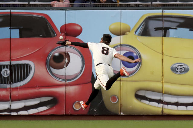 San Francisco Giants left fielder Hunter Pence (8) can't catch up to an Atlanta Braves Freddie Freeman (5) double in the first inning of a baseball game in San Francisco, Monday, Sept. 10, 2018. (AP Photo/Scot Tucker)