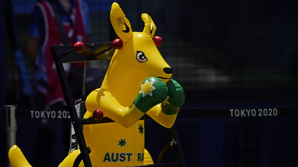 A boxing kangaroo is set to watch from the Australia dugout during a softball game between Australia and United States at the 2020 Summer Olympics. (AP Photo/Sue Ogrocki)