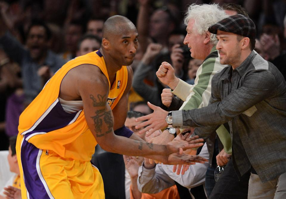 LOS ANGELES, CA - MAY 12:  Kobe Bryant #24 of the Los Angeles Lakers reacts with Justin Timberlake after Bryant makes a basket in the fourth quarter against the Denver Nuggets in Game Seven of the Western Conference Quarterfinals in the 2012 NBA Playoffs on May 12, 2012 at Staples Center in Los Angeles, California. NOTE TO USER: User expressly acknowledges and agrees that, by downloading and or using this photograph, User is consenting to the terms and conditions of the Getty Images License Agreement.  (Photo by Harry How/Getty Images)