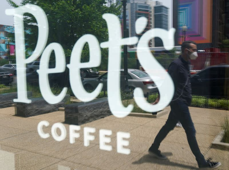 FILE PHOTO: A man passes a Peet's coffee shop in Washington, USA