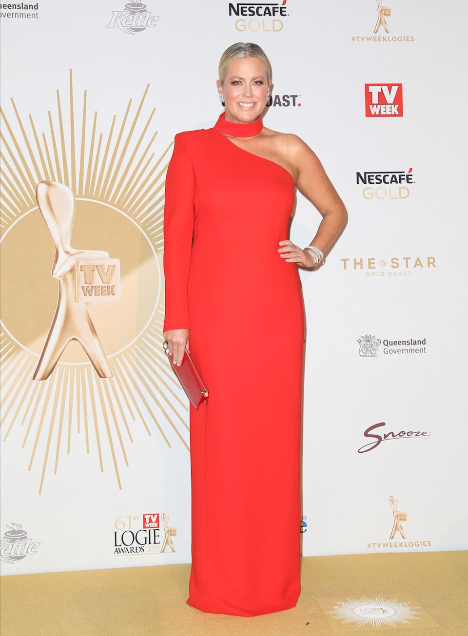 Samantha Armytage wears a red one-shoulder column gown at the 61st Annual TV WEEK Logie Awards at The Star Gold Coast on June 30, 2019 on the Gold Coast, Australia.