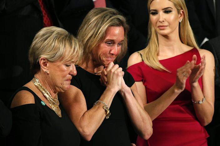 """Carryn Owens (center), widow of William """"Ryan"""" Owens, applauds with Ivanka Trump (right), after being mentioned by President Trump. (Photo: Kevin Lamarque/Reuters)"""