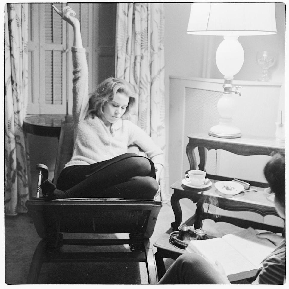 <p>Jane Fonda curls up in an armchair and studies the lines for her upcoming part in Lee Strasberg's acting program. </p>