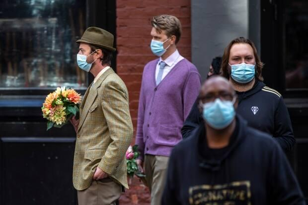 Film crew stages on a Gastown street during the production of The Mysterious Benedict Society in Vancouver on Monday. (Ben Nelms/CBC - image credit)