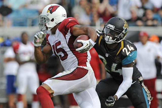 Arizona Cardinals wide receiver Michael Floyd (15) runs past Jacksonville Jaguars cornerback Will Blackmon (24) for a 91-yard touchdown in the second half of an NFL football game in Jacksonville, Fla., Sunday, Nov. 17, 2013. (AP Photo/Stephen Morton)