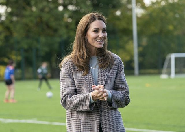 Kate watched the female football players and chatted to students. Arthur Edwards/The Sun