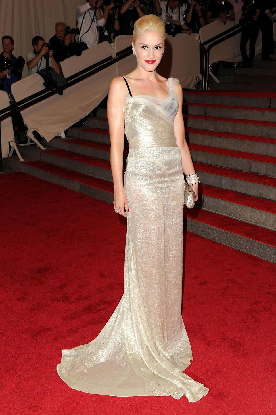 <p>This was a decidedly softer look for Gwen, who showed up to the 2010 Met Gala wrapped in this metallic, floor-sweeping dress.</p>