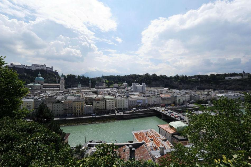 Fortress Hohensalzburg and the old town with Salzach river center.