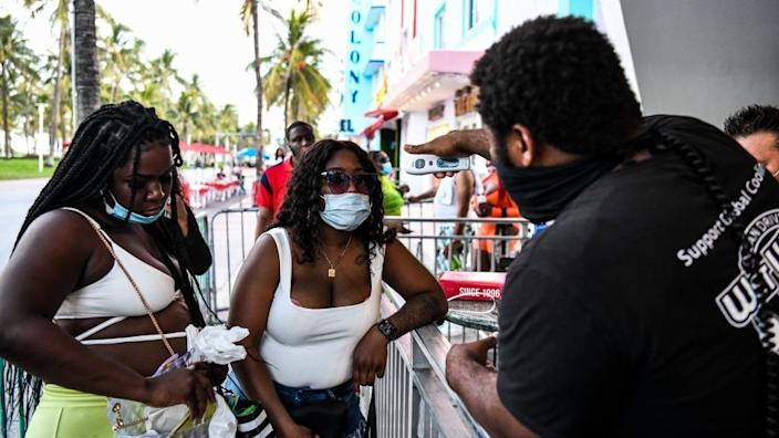 Some Florida businesses have been checking visitors' temperature as they enter
