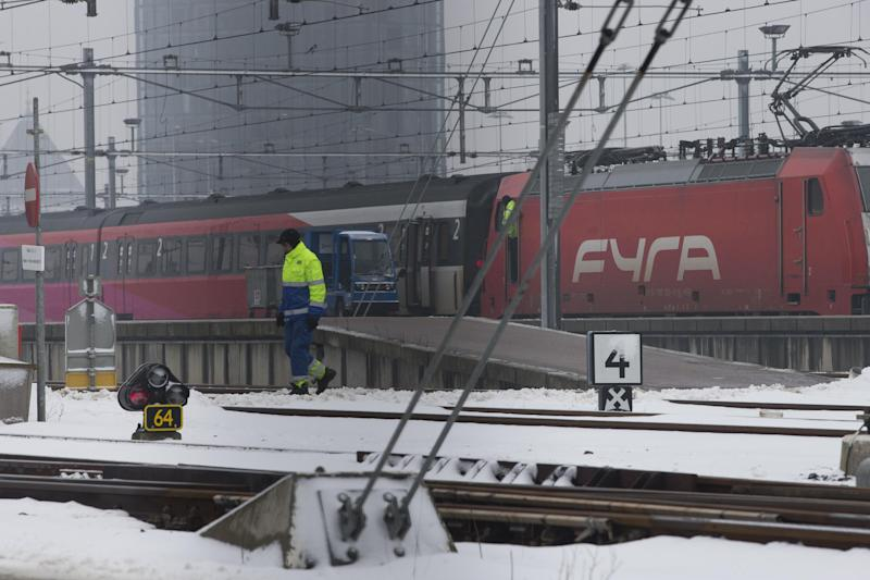 """A Fyra high-speed train, shunted by a locomotive, right, is seen at a railroad siding in Amsterdam, Netherlands, Monday Jan. 21, 2013. When railroad bosses proudly unveiled their new Fyra train connecting Amsterdam and Brussels they called it the """"missing link"""" in Europe's high-speed rail network. Now, the Italian-built trains are missing in action. Technical problems dogged the 250-kmh (155-mph) trains since they came into service last month, repeatedly delaying trips between the Dutch and Belgian capitals that were supposed to shave more than an hour off the regular intercity service the Fyra replaced. (AP Photo/Peter Dejong)"""