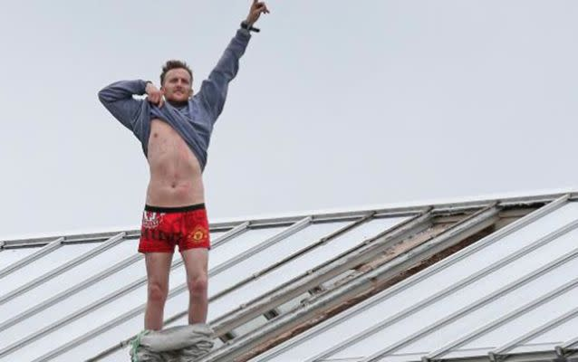 Convicted murderer Stuart Horner stripped down to his boxer shots while protesting on top of the roof of HMP Manchester. Source: Evening Standard.