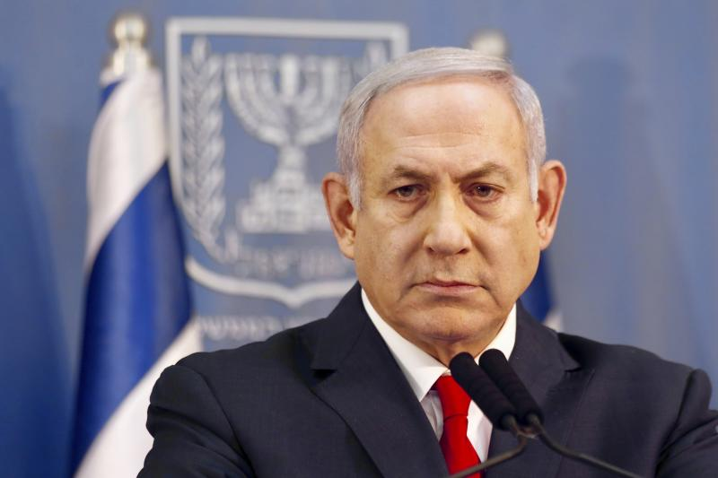 Israeli Prime Minister Benjamin Netanyahu delivers a statement in Tel Aviv, Israel, Sunday, Nov. 18, 2018. Netanyahu says he will take over temporarily as defense minister as early elections still loom. (AP Photo/Ariel Schalit)