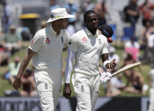 FILE- In this Nov. 24, 2019 file photo, England's Stuart Broad, left, chats with teammate Jofra Archer during play on day four of the first cricket test between England and New Zealand at Bay Oval in Mount Maunganui, New Zealand. A New Zealand fan who racially abused Archer during a test match at Bay Oval in November has been banned from domestic and international matches in New Zealand for two years. (AP Photo/Mark Baker)