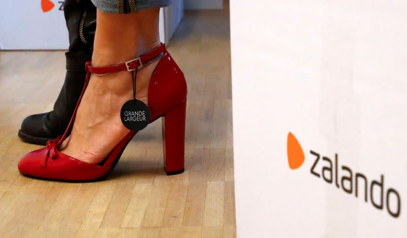 FILE PHOTO: A fitting model checks out sizes for a shoe which goes on sale at the online shop of fashion retailer Zalando in Berlin