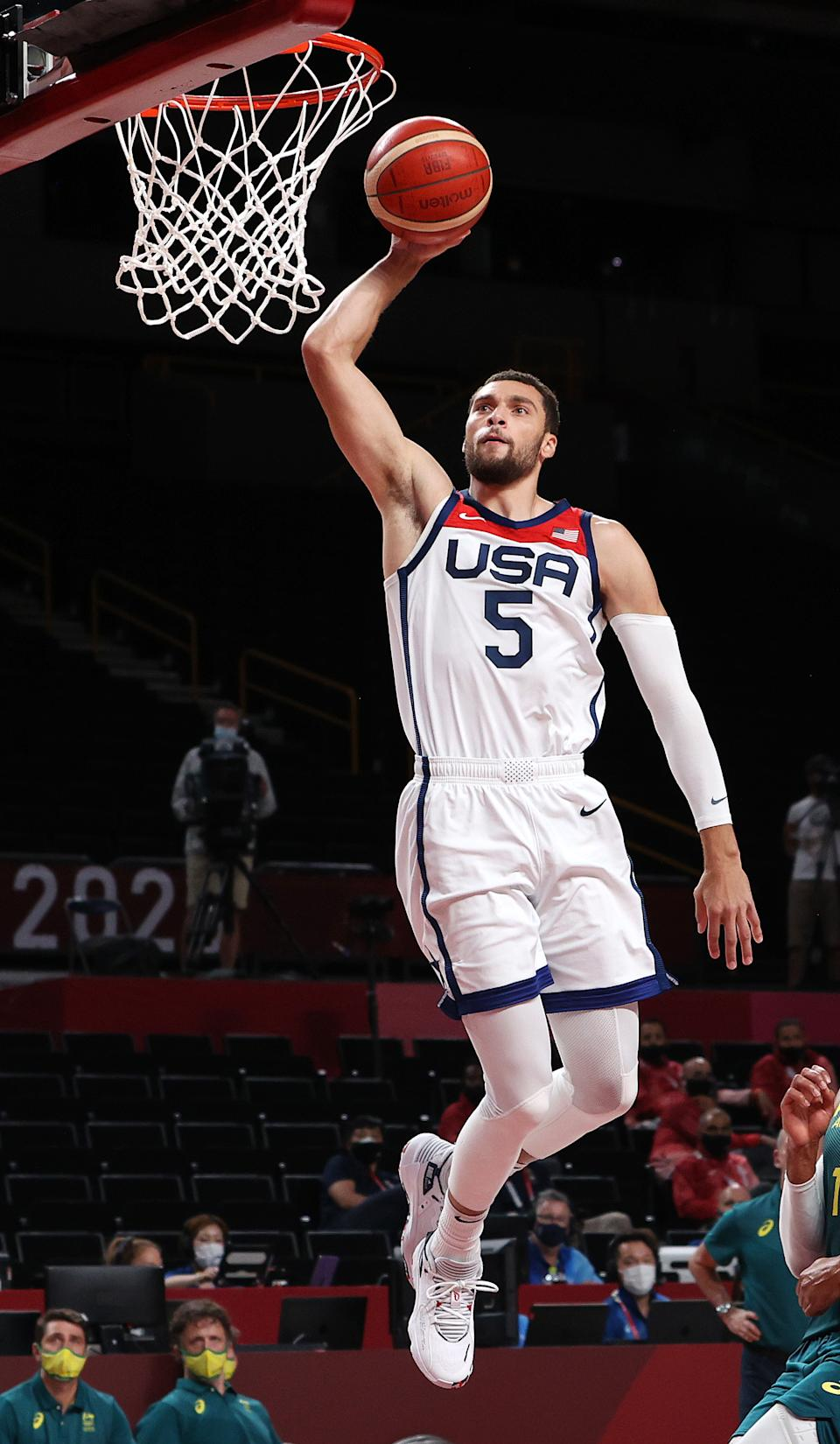 <p>Zachary Lavine #5 of Team United States goes up for a dunk against Team Australia during the second half of a Men's Basketball quarterfinals game on day thirteen of the Tokyo 2020 Olympic Games at Saitama Super Arena on August 05, 2021 in Saitama, Japan. (Photo by Kevin C. Cox/Getty Images)</p>