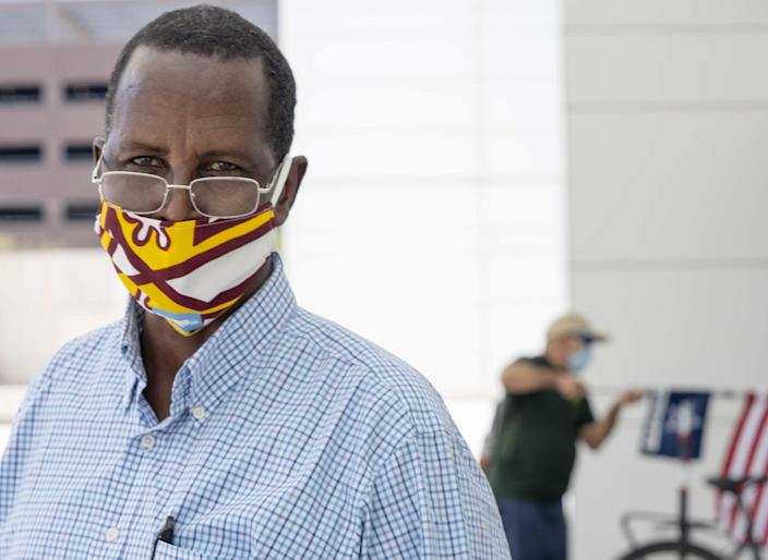"""Aden Bashir Hillowle, 57, from Somalia, is an overland truck driver and a married father of nine children. His naturalization ceremony was scheduled for March 12, 2020, but was put on hold because of the new coronavirus pandemic, when the government temporarily suspended naturalization ceremonies. He was relieved when he received a letter informing him that his ceremony finally had been rescheduled for July 10, four months after he was supposed to be sworn in as a new U.S. citizen. """"Actually, this is my best day in the world. This is the opportunity country,"""" he said."""