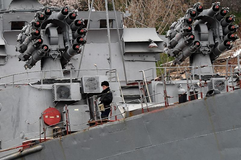 A Russian soldier stands on the deck of anti-submarine vessel in the port of Sevastopol, on March 8, 2014