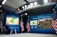 US President Joe Biden is seen receiving a briefing by emergency management officials at the White House on August 28, 2021 (AFP/SAUL LOEB)