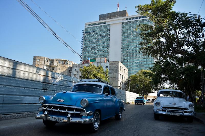 Old American cars are parked in February 2019 outside the Habana Libre Hotel, formerly the Havana Hilton, one of many properties that could be subject to US lawsuits under a newly enforced law (AFP Photo/YAMIL LAGE)